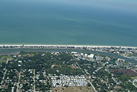 Indian Shores north aerial photos of real estate along the gulf of Mexico on the West Coast of Florida.  View the Beachfront homes and condos listed for sale. Includes Residential and commercial real estate
