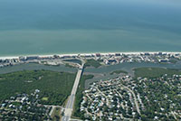 South Indian Shores Florida. Aerial view facing west over the Gulf of Mexico. These are photos of beach front condos and homes listed for sale on the mls.  waterfront real estate on the west coast of Florida